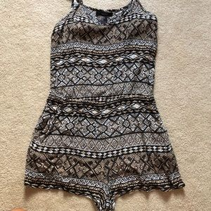Forever 21 patterned romper with a cut out in back